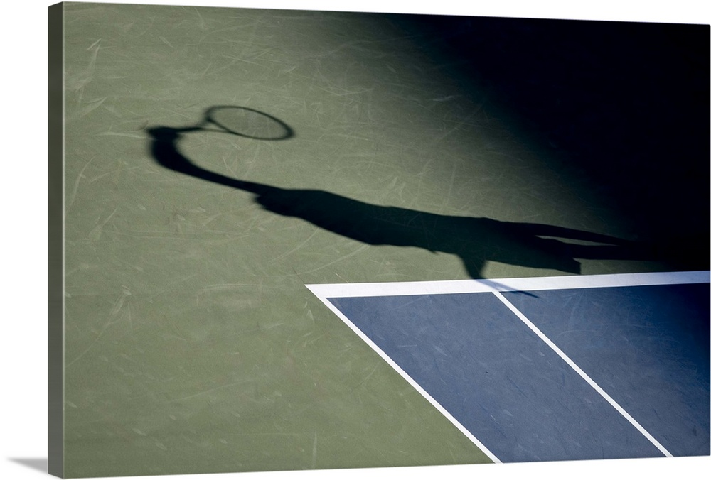 Large Solid-Faced Canvas Print Wall Art Print 30 x 20 entitled Shadow of tennis player serving Solid-Faced Canvas Print entitled Shadow of tennis player serving.  TN0417 106019.  Multiple sizes available.  Primary colors within this image include Black, Gray, White.  Made in the USA.  Satisfaction guaranteed.  Inks used are latex-based and designed to last.  Canvas depth is 1.25 and includes a finished backing with pre-installed hanging hardware.  Featuring a proprietary design, our canvases produce the tightest corners without any bubbles, ripples, or bumps and will not warp or sag over time.