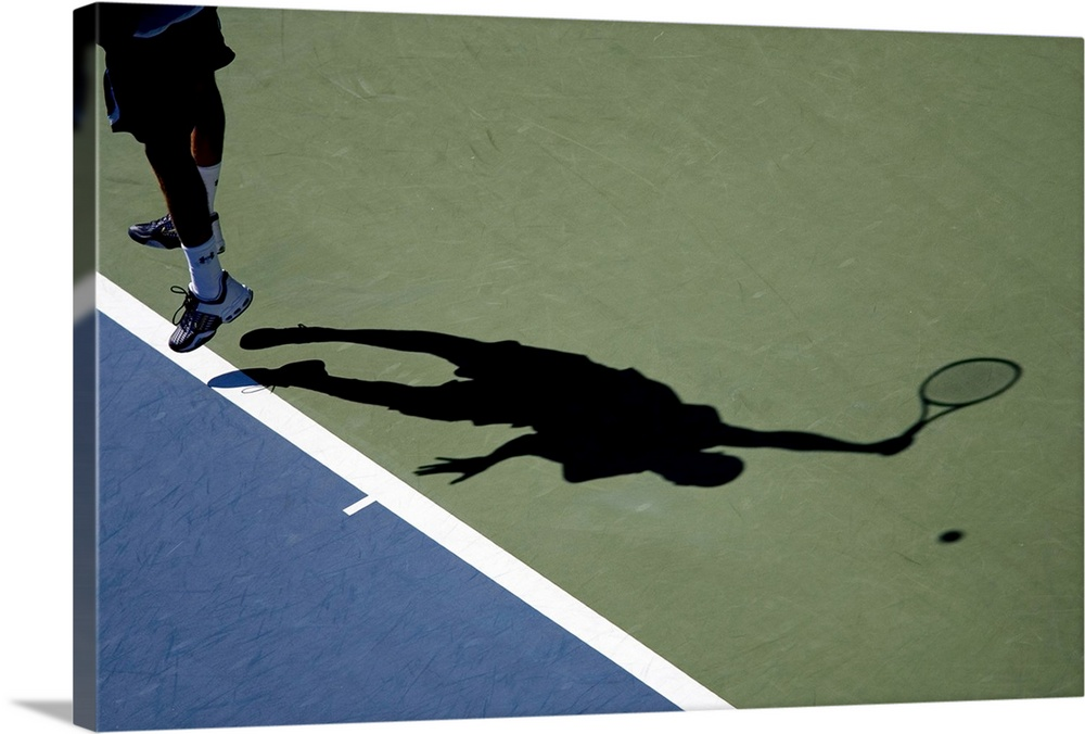 Large Solid-Faced Canvas Print Wall Art Print 30 x 20 entitled Shadow of tennis player serving Solid-Faced Canvas Print entitled Shadow of tennis player serving.  TN0417 106024.  Multiple sizes available.  Primary colors within this image include Black, Light Gray, White, Muted Blue.  Made in the USA.  All products come with a 365 day workmanship guarantee.  Archival-quality UV-resistant inks.  Featuring a proprietary design, our canvases produce the tightest corners without any bubbles, ripples, or bumps and will not warp or sag over time.  Archival inks prevent fading and preserve as much fine detail as possible with no over-saturation or color shifting.