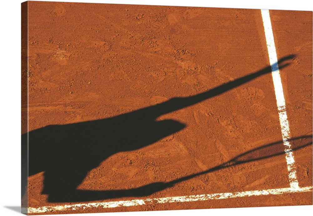 Large Solid-Faced Canvas Print Wall Art Print 30 x 20 entitled Shadow of tennis player serving on clay court Solid-Faced Canvas Print entitled Shadow of tennis player serving on clay court.  TN0472 107480.  Multiple sizes available.  Primary colors within this image include Brown, Dark Gray, White.  Made in USA.  All products come with a 365 day workmanship guarantee.  Inks used are latex-based and designed to last.  Archival inks prevent fading and preserve as much fine detail as possible with no over-saturation or color shifting.  Canvas depth is 1.25 and includes a finished backing with pre-installed hanging hardware.
