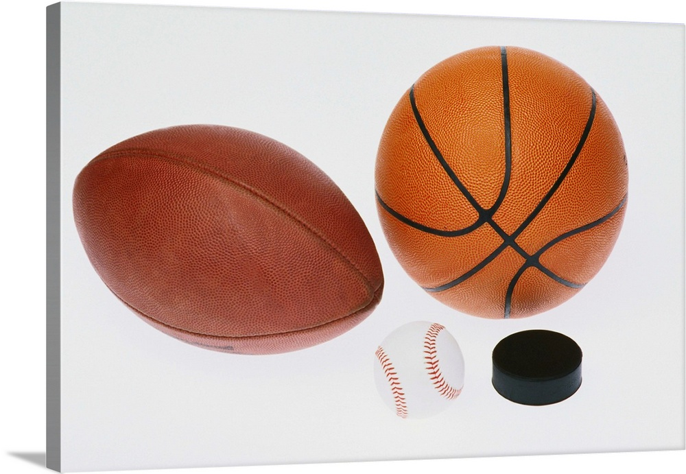 Large Gallery-Wrapped Canvas Wall Art Print 24 x 16 entitled Sports equipment: football, baseball, basketball, hockey puck, Gallery-Wrapped Canvas entitled Sports equipment football baseball basketball hockey puck.  Multiple sizes available.  Primary colors within this image include Brown Dark Gray White.  Made in the USA.  All products come with a 365 day workmanship guarantee.  Archival-quality UV-resistant inks.  Canvases are stretched across a 1.5 inch thick wooden frame with easy-to-mount hanging hardware.  Museum-quality artist-grade canvas mounted on sturdy wooden stretcher bars 1.5 thick.  Comes ready to hang.