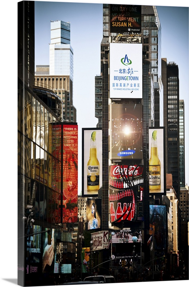 Large Solid-Faced Canvas Print Wall Art Print 20 x 30 entitled Advertisements in Times Square Solid-Faced Canvas Print entitled Advertisements in Times Square.  Fine art photo of the billboards and electronic signs on the buildings in Times Square.  Multiple sizes available.  Primary colors within this image include Dark Red, Dark Yellow, Black, Silver.  Made in USA.  Satisfaction guaranteed.  Archival-quality UV-resistant inks.  Archival inks prevent fading and preserve as much fine detail as possible with no over-saturation or color shifting.  Canvas depth is 1.25 and includes a finished backing with pre-installed hanging hardware.