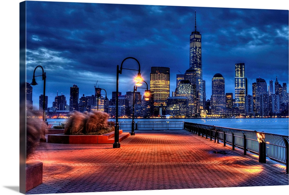 Large Solid-Faced Canvas Print Wall Art Print 36 x 24 entitled Freedom Tower Solid-Faced Canvas Print entitled Freedom Tower.  View from Exchange Place, Jersey City, New Jersey.  Multiple sizes available.  Primary colors within this image include Pink, Black, White, Muted Blue.  Made in the USA.  All products come with a 365 day workmanship guarantee.  Inks used are latex-based and designed to last.  Featuring a proprietary design, our canvases produce the tightest corners without any bubbles, ripples, or bumps and will not warp or sag over time.  Canvas depth is 1.25 and includes a finished backing with pre-installed hanging hardware.