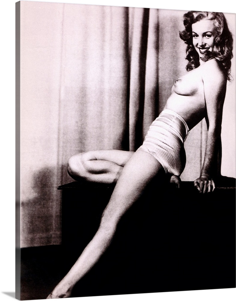 Large Gallery-Wrapped Canvas Wall Art Print 16 x 20 entitled Marilyn Monroe B Gallery-Wrapped Canvas entitled Marilyn Monroe B.  Boudoir photo of Marilyn Monroe topless and leaning back on a stand in front of a curtain smiling at the camera.  Multiple sizes available.  Primary colors within this image include Black Gray White.  Made in the USA.  Satisfaction guaranteed.  Archival-quality UV-resistant inks.  Canvases have a UVB protection built in to protect against fading and moisture and are designed to last for over 100 years.  Canvas is a 65 polyester 35 cotton base with two acrylic latex primer basecoats and a semi-gloss inkjet receptive topcoat.