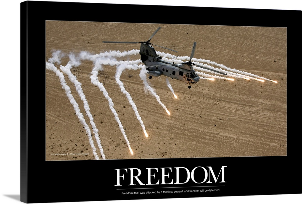 Large Solid-Faced Canvas Print Wall Art Print 36 x 24 entitled Marine Poster: A U.S. Marine Corps CH-46 Sea Knight helicop... Solid-Faced Canvas Print entitled Marine Poster A U.S. Marine Corps CH-46 Sea Knight helicopter launching flares.  A military helicopter is pictured as it shoots numerous flares above the desert. The word freedom and a quote are written below it.  Multiple sizes available.  Primary colors within this image include Black, Gray, White.  Made in USA.  Satisfaction guaranteed.  Inks used are latex-based and designed to last.  Archival inks prevent fading and preserve as much fine detail as possible with no over-saturation or color shifting.  Canvas depth is 1.25 and includes a finished backing with pre-installed hanging hardware.