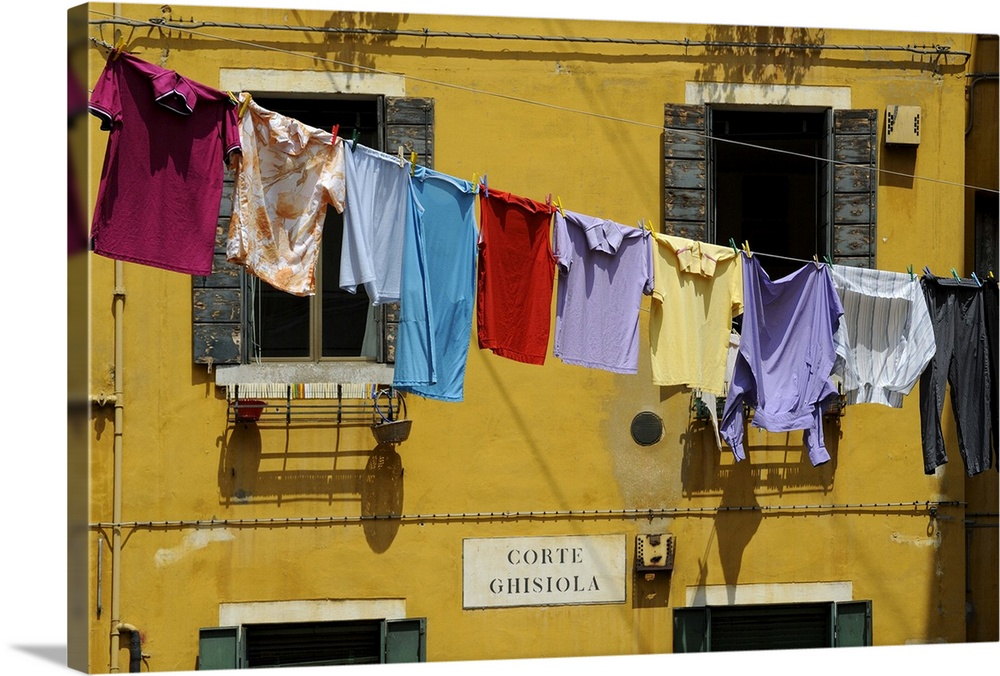 Large Gallery-Wrapped Canvas Wall Art Print 24 x 16 entitled Clothes hanging on a washing line between houses, Venice, Ven... Gallery-Wrapped Canvas entitled Clothes hanging on a washing line between houses, Venice, Veneto, Italy.  Multiple sizes available.  Primary colors within this image include Dark Red, Brown, Dark Yellow, Black.  Made in USA.  All products come with a 365 day workmanship guarantee.  Inks used are latex-based and designed to last.  Canvas is designed to prevent fading.  Canvas is acid-free and 20 millimeters thick.