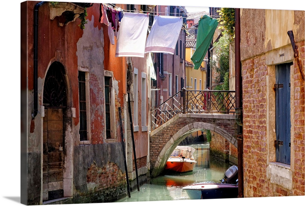 Large Solid-Faced Canvas Print Wall Art Print 30 x 20 entitled Clothes lines, Venice, Veneto, Italy Solid-Faced Canvas Print entitled Clothes lines, Venice, Veneto, Italy.  Multiple sizes available.  Primary colors within this image include Red, Black, White, Dark Forest Green.  Made in the USA.  Satisfaction guaranteed.  Archival-quality UV-resistant inks.  Featuring a proprietary design, our canvases produce the tightest corners without any bubbles, ripples, or bumps and will not warp or sag over time.  Canvas is handcrafted and made-to-order in the United States using high quality artist-grade canvas.