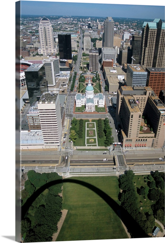 Large Solid-Faced Canvas Print Wall Art Print 20 x 30 entitled Downtown seen from Gateway Arch, which casts a shadow, St. ... Solid-Faced Canvas Print entitled Downtown seen from Gateway Arch, which casts a shadow, St. Louis, Missouri.  Multiple sizes available.  Primary colors within this image include Sky Blue, Black, White, Dark Forest Green.  Made in USA.  All products come with a 365 day workmanship guarantee.  Archival-quality UV-resistant inks.  Featuring a proprietary design, our canvases produce the tightest corners without any bubbles, ripples, or bumps and will not warp or sag over time.  Archival inks prevent fading and preserve as much fine detail as possible with no over-saturation or color shifting.