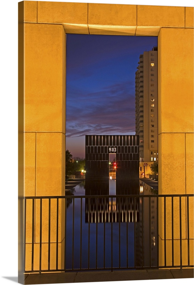 Large Solid-Faced Canvas Print Wall Art Print 20 x 30 entitled Gate of Time, Oklahoma City National Memorial, Oklahoma, USA Solid-Faced Canvas Print entitled Gate of Time, Oklahoma City National Memorial, Oklahoma, USA.  Multiple sizes available.  Primary colors within this image include Orange, Black, White, Muted Blue.  Made in USA.  All products come with a 365 day workmanship guarantee.  Inks used are latex-based and designed to last.  Canvas is handcrafted and made-to-order in the United States using high quality artist-grade canvas.  Archival inks prevent fading and preserve as much fine detail as possible with no over-saturation or color shifting.