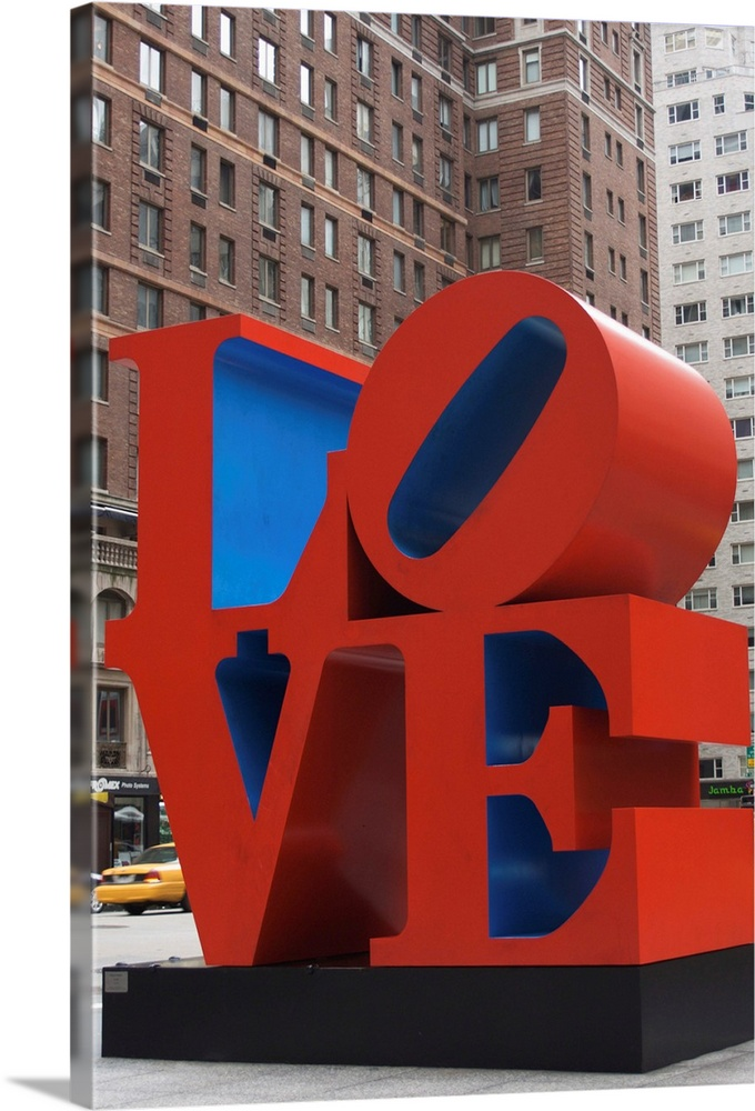 Large Solid-Faced Canvas Print Wall Art Print 20 x 30 entitled Love Sculpture by Robert Indiana, 6th Avenue, Manhattan, NY... Solid-Faced Canvas Print entitled Love Sculpture by Robert Indiana, 6th Avenue, Manhattan, NYC, New York, USA.  Multiple sizes available.  Primary colors within this image include Dark Red, Dark Gray, Light Gray, Royal Blue.  Made in USA.  All products come with a 365 day workmanship guarantee.  Archival-quality UV-resistant inks.  Canvas is handcrafted and made-to-order in the United States using high quality artist-grade canvas.  Archival inks prevent fading and preserve as much fine detail as possible with no over-saturation or color shifting.
