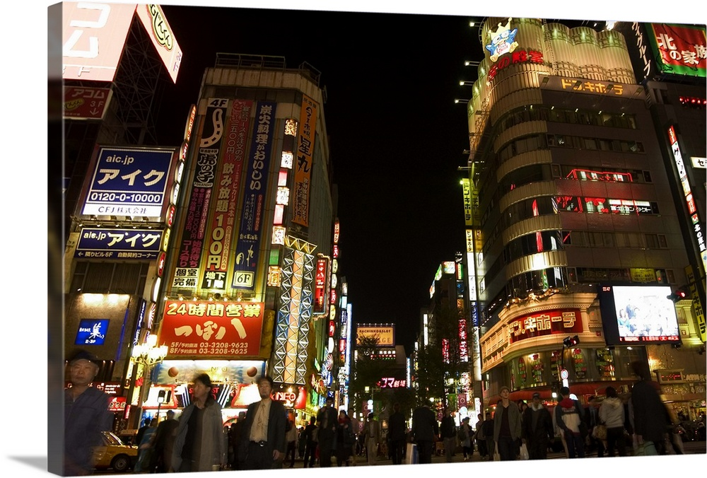 Large Solid-Faced Canvas Print Wall Art Print 30 x 20 entitled Night time city lights, Shinjuku, Tokyo, Honshu, Japan Solid-Faced Canvas Print entitled Night time city lights, Shinjuku, Tokyo, Honshu, Japan.  Multiple sizes available.  Primary colors within this image include Brown, Peach, Black, White.  Made in the USA.  Satisfaction guaranteed.  Archival-quality UV-resistant inks.  Canvas depth is 1.25 and includes a finished backing with pre-installed hanging hardware.  Archival inks prevent fading and preserve as much fine detail as possible with no over-saturation or color shifting.