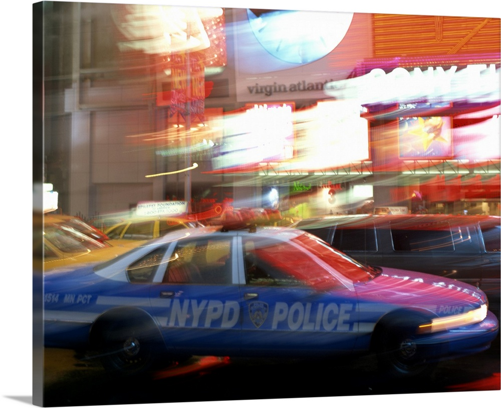 Large Solid-Faced Canvas Print Wall Art Print 30 x 24 entitled NYPD police car speeding through Times Square, New York Cit... Solid-Faced Canvas Print entitled NYPD police car speeding through Times Square, New York City, New York.  Multiple sizes available.  Primary colors within this image include Orange, Dark Blue, Black, White.  Made in USA.  All products come with a 365 day workmanship guarantee.  Archival-quality UV-resistant inks.  Canvas depth is 1.25 and includes a finished backing with pre-installed hanging hardware.  Archival inks prevent fading and preserve as much fine detail as possible with no over-saturation or color shifting.