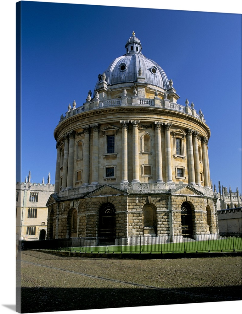 Large Solid-Faced Canvas Print Wall Art Print 24 x 30 entitled Radcliffe Camera, Oxford, Oxfordshire, England Solid-Faced Canvas Print entitled Radcliffe Camera, Oxford, Oxfordshire, England.  Multiple sizes available.  Primary colors within this image include Forest Green, Black, White, Muted Blue.  Made in USA.  All products come with a 365 day workmanship guarantee.  Inks used are latex-based and designed to last.  Archival inks prevent fading and preserve as much fine detail as possible with no over-saturation or color shifting.  Featuring a proprietary design, our canvases produce the tightest corners without any bubbles, ripples, or bumps and will not warp or sag over time.