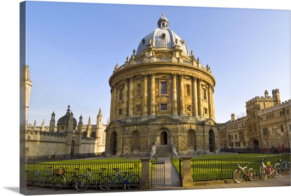 Large Solid-Faced Canvas Print Wall Art Print 30 x 20 entitled The Radcliffe Camera, Oxford, Oxfordshire, England, UK Solid-Faced Canvas Print entitled The Radcliffe Camera, Oxford, Oxfordshire, England, UK.  Multiple sizes available.  Primary colors within this image include Dark Yellow, Peach, Black, Pale Blue.  Made in USA.  All products come with a 365 day workmanship guarantee.  Archival-quality UV-resistant inks.  Featuring a proprietary design, our canvases produce the tightest corners without any bubbles, ripples, or bumps and will not warp or sag over time.  Archival inks prevent fading and preserve as much fine detail as possible with no over-saturation or color shifting.