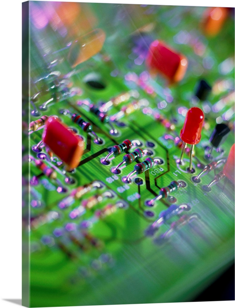 Large Solid-Faced Canvas Print Wall Art Print 30 x 40 entitled Close-up of an electronic circuit board Solid-Faced Canvas Print entitled Close-up of an electronic circuit board.  Circuit board. Close-up view of an electronic circuit board, showing resistors centre, a Light Emitting Diode LED, centre right and a capacitor red, centre left. Individual components on a circuit board are connected by electrical pathways. Circuit boards have uses in a variety of electronic products.  Multiple sizes available.  Primary colors within this image include Dark Red, Brown, Forest Green, Dark Forest Green.  Made in the USA.  All products come with a 365 day workmanship guarantee.  Archival-quality UV-resistant inks.  Featuring a proprietary design, our canvases produce the tightest corners without any bubbles, ripples, or bumps and will not warp or sag over time.  Canvas is handcrafted and made-to-order in the United States using high quality artist-grade canvas.