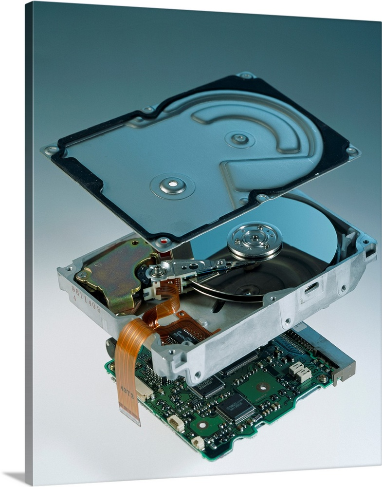 Large Solid-Faced Canvas Print Wall Art Print 24 x 30 entitled Computer hard disk assembly Solid-Faced Canvas Print entitled Computer hard disk assembly.  Computer hard disk assembly. Component parts of a hard disk showing the outer aluminium casing top, the hard disk platter and readwrite head centre, and the controller electronics bottom. Data are stored on written and recalled from read the hard disc by changing the electromagnetism of the platter, which is coated with magnetic material. The readwrite head metal arm at centre can move over the spinning platter 50 times per second. The electronic circuitry controls the movement of the readwrite head and the motor that spins the platter. It also organizes the assembly of magnetic domains on the platter in which data are stored.  Multiple sizes available.  Primary colors within this image include Brown, Black, Gray, White.  Made in USA.  Satisfaction guaranteed.  Inks used are latex-based and designed to last.  Canvas is handcrafted and made-to-order in the United States using high quality artist-grade canvas.  Archival inks prevent fading and preserve as much fine detail as possible with no over-saturation or color shifting.