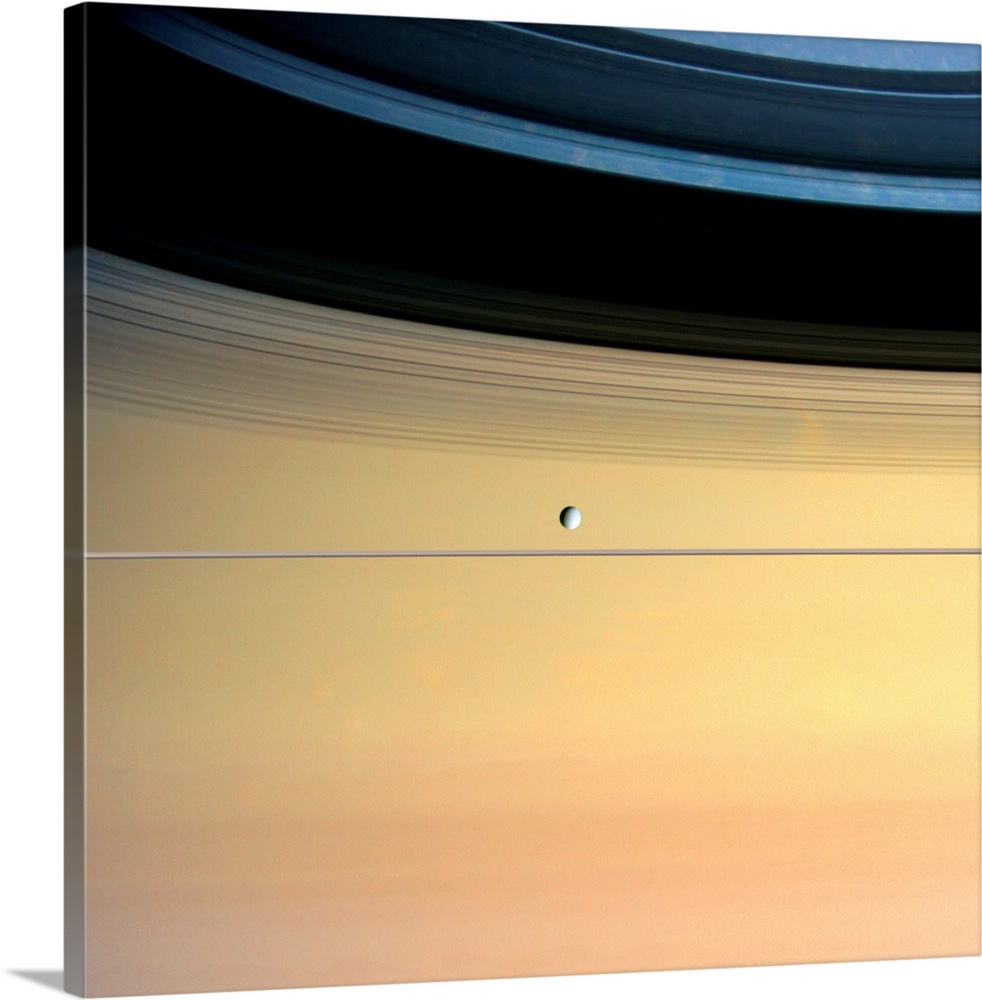 Large Solid-Faced Canvas Print Wall Art Print 20 x 20 entitled Dione and ring shadows on Saturn, Cassini Solid-Faced Canvas Print entitled Dione and ring shadows on Saturn, Cassini.  Dione and ring shadows on Saturn, Cassini image. Dione is around 1123 kilometres in diameter and orbits some 377,000 kilometres from the giant Saturn. Saturns rings are edge-on in this view, and run across centre just below Dione. Due to the high inclination of Saturn to the Sun at this time, the shadows of the rings are widely spread across its clouds in upper frame. The varying densities of the rings are responsible for the varying darkness of the shadows. This image was taken on 22nd September 2005, when Cassini was around 803,000 kilometres from Dione.  Multiple sizes available.  Primary colors within this image include Peach, Black, Gray.  Made in USA.  All products come with a 365 day workmanship guarantee.  Archival-quality UV-resistant inks.  Canvas is handcrafted and made-to-order in the United States using high quality artist-grade canvas.  Featuring a proprietary design, our canvases produce the tightest corners without any bubbles, ripples, or bumps and will not warp or sag over time.