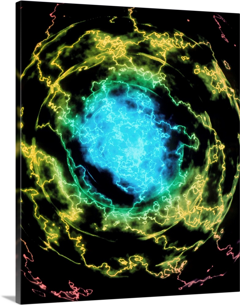 Large Solid-Faced Canvas Print Wall Art Print 24 x 30 entitled Electron structure of helium atom Solid-Faced Canvas Print entitled Electron structure of helium atom.  Electron density of a helium atom. This image represents the quantum cloud of electrons surrounding a helium atom. The colours represent the local electric charge density, essentially the probability that one might find one of the atoms four electrons at a given point. The colours run from blue highest to red lowest. The chaotic appearance of the image is due to the presence of a nearby charged particle when in equilibrium the atom would appear more symmetrical. This is a more appropriate image than the older ideas of fixed orbitals for electrons, sometimes referred to as the Bohr Model, and is due to the principles of modern quantum theory.  Multiple sizes available.  Primary colors within this image include Dark Yellow, Light Yellow, Black, Teal.  Made in USA.  All products come with a 365 day workmanship guarantee.  Archival-quality UV-resistant inks.  Canvas depth is 1.25 and includes a finished backing with pre-installed hanging hardware.  Canvas is handcrafted and made-to-order in the United States using high quality artist-grade canvas.