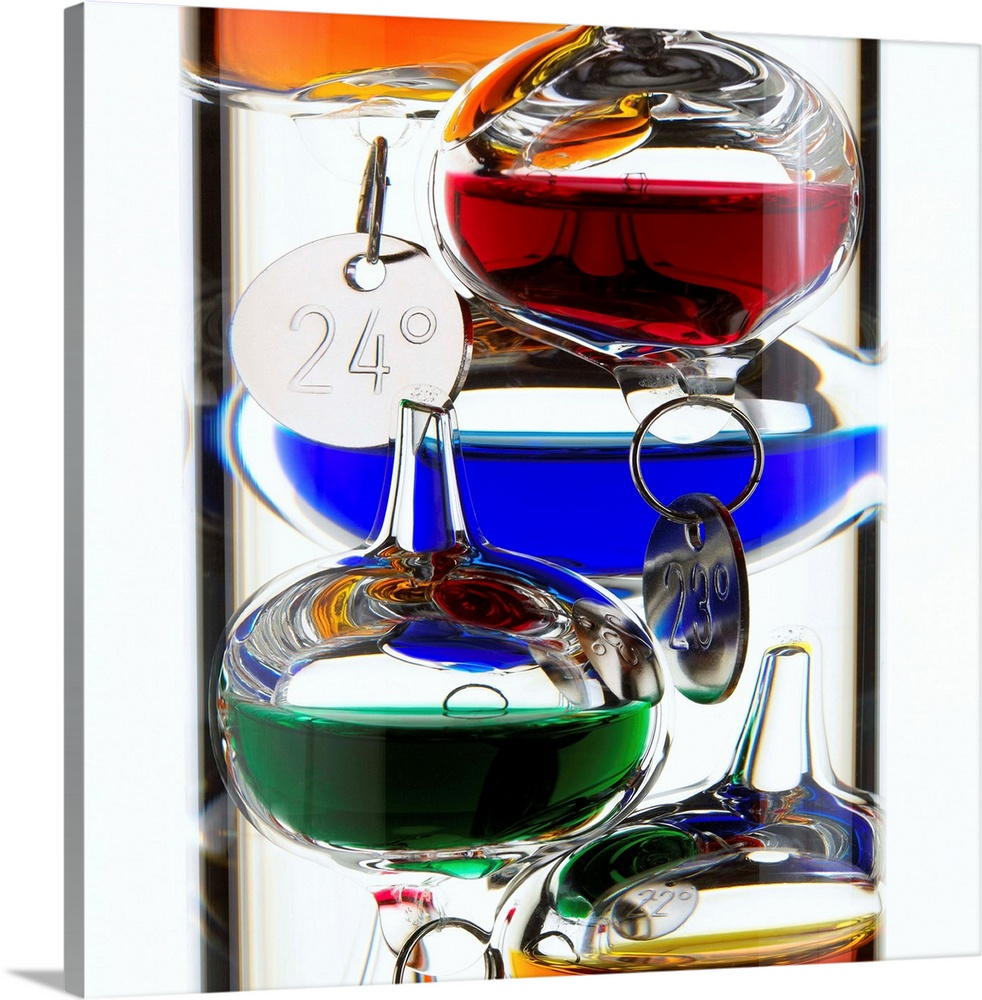 Large Solid-Faced Canvas Print Wall Art Print 20 x 20 entitled Galileo thermometer Solid-Faced Canvas Print entitled Galileo thermometer.  Galileo thermometer.  Multiple sizes available.  Primary colors within this image include Blue, Dark Red, Black, White.  Made in USA.  Satisfaction guaranteed.  Inks used are latex-based and designed to last.  Archival inks prevent fading and preserve as much fine detail as possible with no over-saturation or color shifting.  Canvas depth is 1.25 and includes a finished backing with pre-installed hanging hardware.