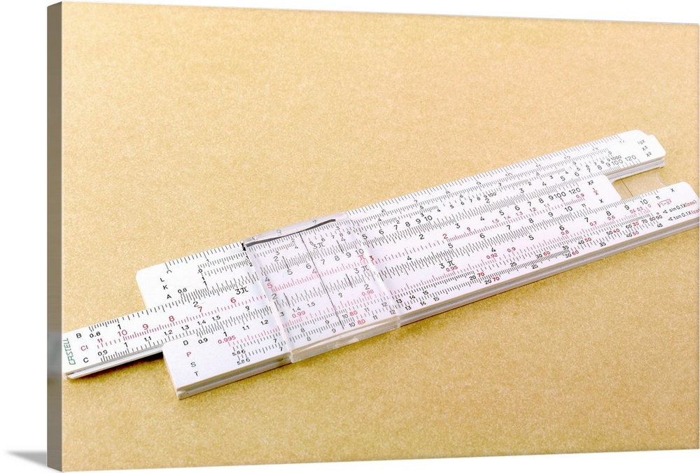 Large Solid-Faced Canvas Print Wall Art Print 30 x 20 entitled Photograph of logarithmic slide rule Solid-Faced Canvas Print entitled Photograph of logarithmic slide rule.  Logarithmic slide rule. This adjustable ruler contains the values for logs, which are used to aid multiplication and division. Logarithms are mathematical functions relating numbers to the powers of a set base number such as ten. Slide-rules have been superseded by the use of electronic calculators.  Multiple sizes available.  Primary colors within this image include Peach, Gray.  Made in the USA.  Satisfaction guaranteed.  Inks used are latex-based and designed to last.  Archival inks prevent fading and preserve as much fine detail as possible with no over-saturation or color shifting.  Featuring a proprietary design, our canvases produce the tightest corners without any bubbles, ripples, or bumps and will not warp or sag over time.