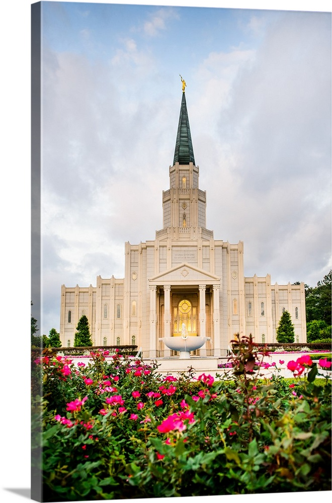 Large Solid-Faced Canvas Print Wall Art Print 20 x 30 entitled Houston Texas Temple Flowers, Spring, Texas Solid-Faced Canvas Print entitled Houston Texas Temple Flowers, Spring, Texas.  The Houston Dallas Temple is the 97th operating temple and  encompasses nearly 34,000 square feet. The temple site was formerly owned by Don Hand, who attended the groundbreaking ceremony and helped the ideal architect to design the temple.  Multiple sizes available.  Primary colors within this image include Fuschia, Forest Green, Black, White.  Made in USA.  All products come with a 365 day workmanship guarantee.  Inks used are latex-based and designed to last.  Canvas is handcrafted and made-to-order in the United States using high quality artist-grade canvas.  Featuring a proprietary design, our canvases produce the tightest corners without any bubbles, ripples, or bumps and will not warp or sag over time.