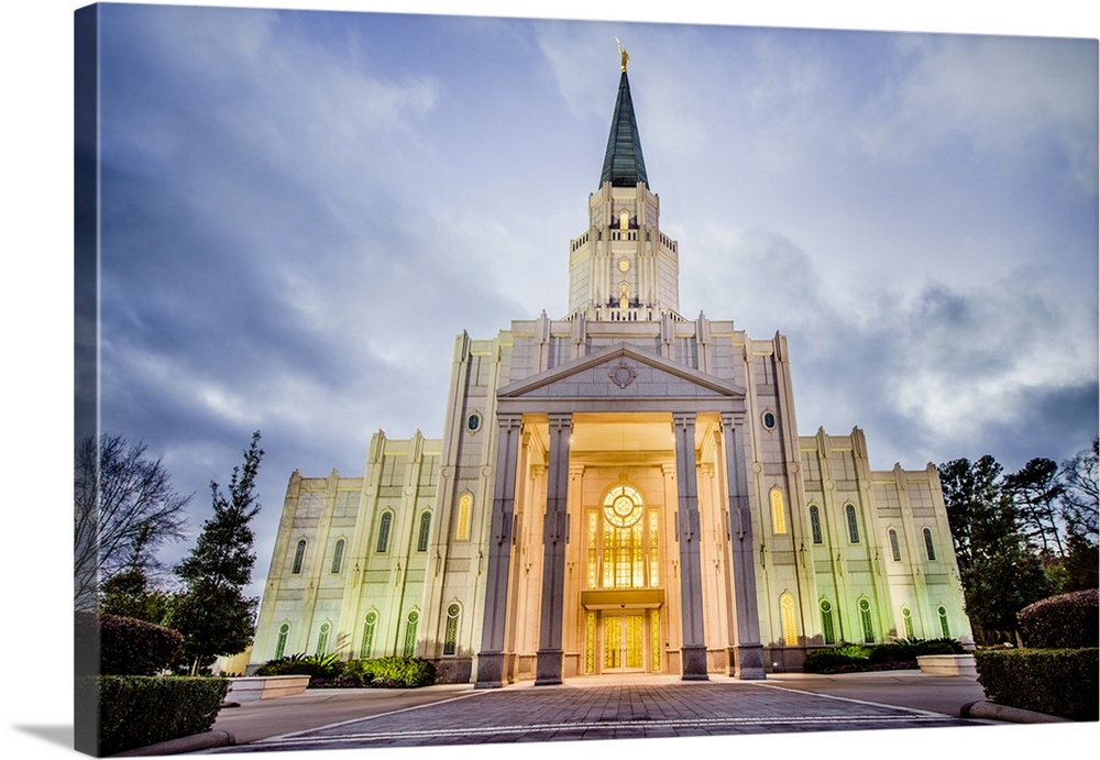 Large Solid-Faced Canvas Print Wall Art Print 30 x 20 entitled Houston Texas Temple, Lights in the Evening, Spring, Texas Solid-Faced Canvas Print entitled Houston Texas Temple, Lights in the Evening, Spring, Texas.  The Houston Dallas Temple is the 97th operating temple and  encompasses nearly 34,000 square feet. The temple site was formerly owned by Don Hand, who attended the groundbreaking ceremony and helped the ideal architect to design the temple.  Multiple sizes available.  Primary colors within this image include Dark Yellow, Peach, Black, Pale Blue.  Made in the USA.  All products come with a 365 day workmanship guarantee.  Archival-quality UV-resistant inks.  Archival inks prevent fading and preserve as much fine detail as possible with no over-saturation or color shifting.  Featuring a proprietary design, our canvases produce the tightest corners without any bubbles, ripples, or bumps and will not warp or sag over time.
