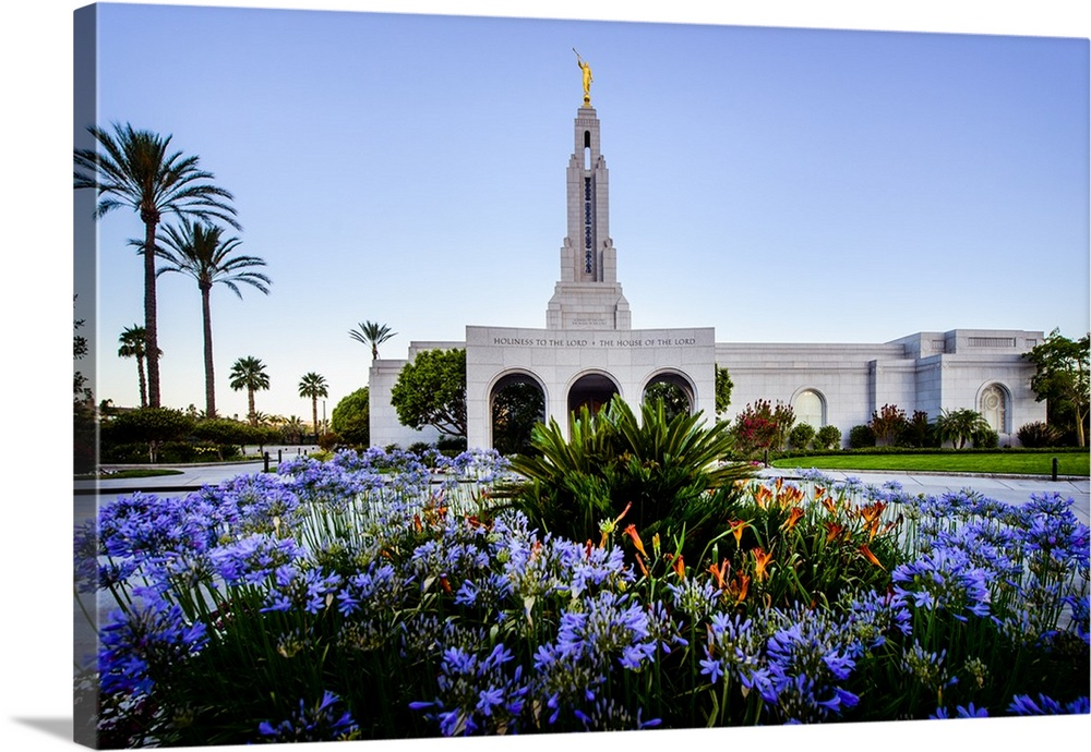 Large Solid-Faced Canvas Print Wall Art Print 30 x 20 entitled Redlands California Temple, Blooming Garden, Redlands, Cali... Solid-Faced Canvas Print entitled Redlands California Temple, Blooming Garden, Redlands, California.  The Redlands California Temple is the 116th operating temple and is surrounded by palm trees in its southern California home. At its dedication, attendees were served orange juice made from oranges grown on the property. The temple was dedicated in 2001 by Deiter F. Uchtdorf and again in 2003 by Gordon B. Hinckley.  Multiple sizes available.  Primary colors within this image include Dark Yellow, Black, Dark Forest Green, Pale Blue.  Made in USA.  All products come with a 365 day workmanship guarantee.  Archival-quality UV-resistant inks.  Canvas is handcrafted and made-to-order in the United States using high quality artist-grade canvas.  Featuring a proprietary design, our canvases produce the tightest corners without any bubbles, ripples, or bumps and will not warp or sag over time.
