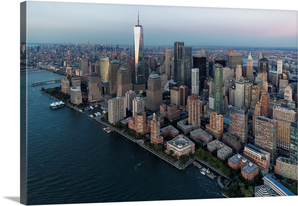 Large Solid-Faced Canvas Print Wall Art Print 36 x 24 entitled Aerial view of Freedom Tower and New York City Solid-Faced Canvas Print entitled Aerial view of Freedom Tower and New York City.  Multiple sizes available.  Primary colors within this image include Black, Gray, Silver.  Made in the USA.  Satisfaction guaranteed.  Archival-quality UV-resistant inks.  Archival inks prevent fading and preserve as much fine detail as possible with no over-saturation or color shifting.  Canvas depth is 1.25 and includes a finished backing with pre-installed hanging hardware.