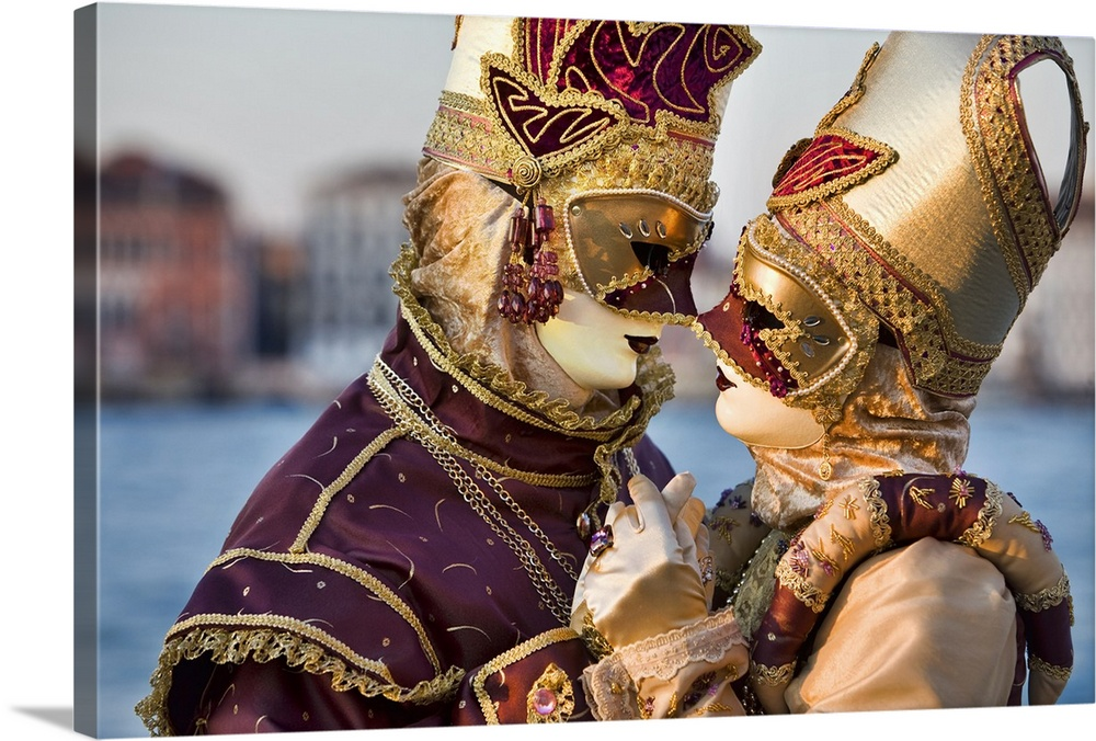 Large Solid-Faced Canvas Print Wall Art Print 30 x 20 entitled Love in masquerade time during Carnival, Venice, Italy Solid-Faced Canvas Print entitled Love in masquerade time during Carnival, Venice, Italy.  Multiple sizes available.  Primary colors within this image include Brown, Peach, Black, Gray Blue.  Made in the USA.  Satisfaction guaranteed.  Archival-quality UV-resistant inks.  Featuring a proprietary design, our canvases produce the tightest corners without any bubbles, ripples, or bumps and will not warp or sag over time.  Archival inks prevent fading and preserve as much fine detail as possible with no over-saturation or color shifting.