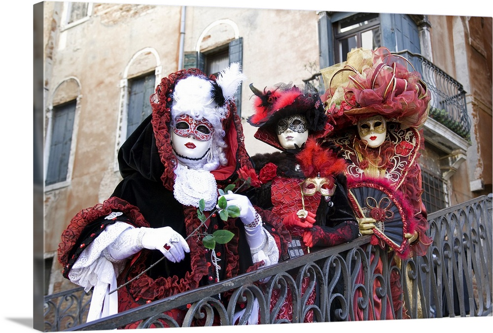 Large Solid-Faced Canvas Print Wall Art Print 30 x 20 entitled Masquerade time during Carnival, Venice, Italy Solid-Faced Canvas Print entitled Masquerade time during Carnival, Venice, Italy.  Multiple sizes available.  Primary colors within this image include Dark Red, Plum, Dark Gray, White.  Made in USA.  Satisfaction guaranteed.  Archival-quality UV-resistant inks.  Archival inks prevent fading and preserve as much fine detail as possible with no over-saturation or color shifting.  Canvas depth is 1.25 and includes a finished backing with pre-installed hanging hardware.