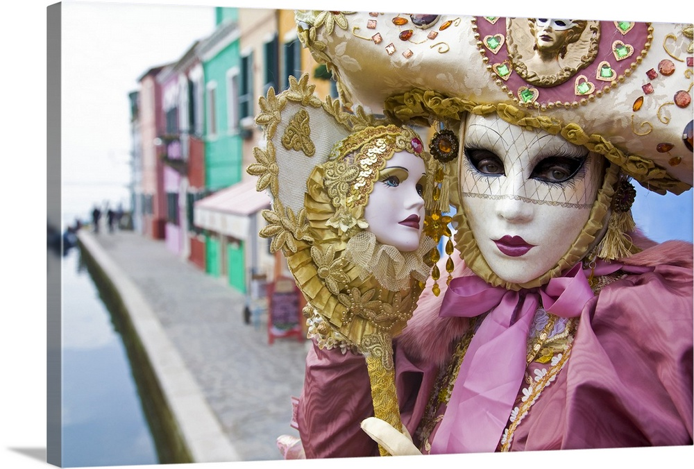 Large Solid-Faced Canvas Print Wall Art Print 30 x 20 entitled Masquerade time during Carnival, Venice, Italy Solid-Faced Canvas Print entitled Masquerade time during Carnival, Venice, Italy.  Multiple sizes available.  Primary colors within this image include Brown, Light Purple, Black, White.  Made in USA.  All products come with a 365 day workmanship guarantee.  Archival-quality UV-resistant inks.  Canvas is handcrafted and made-to-order in the United States using high quality artist-grade canvas.  Canvas depth is 1.25 and includes a finished backing with pre-installed hanging hardware.