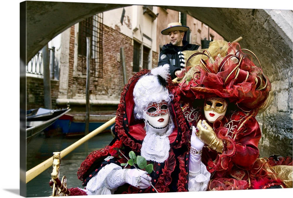 Large Solid-Faced Canvas Print Wall Art Print 30 x 20 entitled Masquerade time on gondola during Carnival, Venice, Italy Solid-Faced Canvas Print entitled Masquerade time on gondola during Carnival, Venice, Italy.  Multiple sizes available.  Primary colors within this image include Dark Red, Pink, Black.  Made in the USA.  All products come with a 365 day workmanship guarantee.  Inks used are latex-based and designed to last.  Archival inks prevent fading and preserve as much fine detail as possible with no over-saturation or color shifting.  Canvas is handcrafted and made-to-order in the United States using high quality artist-grade canvas.