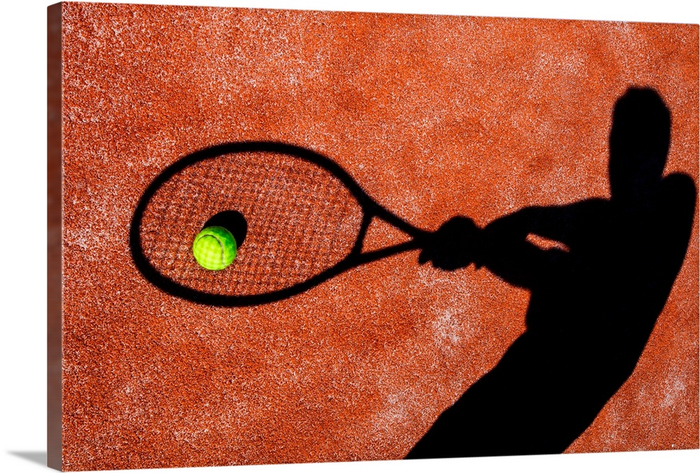 Large Solid-Faced Canvas Print Wall Art Print 30 x 20 entitled Tennis Player's Shadow on a Tennis Court Solid-Faced Canvas Print entitled Tennis Players Shadow on a Tennis Court.  shadow of a tennis player in action on a tennis court conceptual image with a tennis ball lying on.  Multiple sizes available.  Primary colors within this image include Dark Red, Pink, Black, Silver.  Made in USA.  Satisfaction guaranteed.  Archival-quality UV-resistant inks.  Canvas depth is 1.25 and includes a finished backing with pre-installed hanging hardware.  Featuring a proprietary design, our canvases produce the tightest corners without any bubbles, ripples, or bumps and will not warp or sag over time.