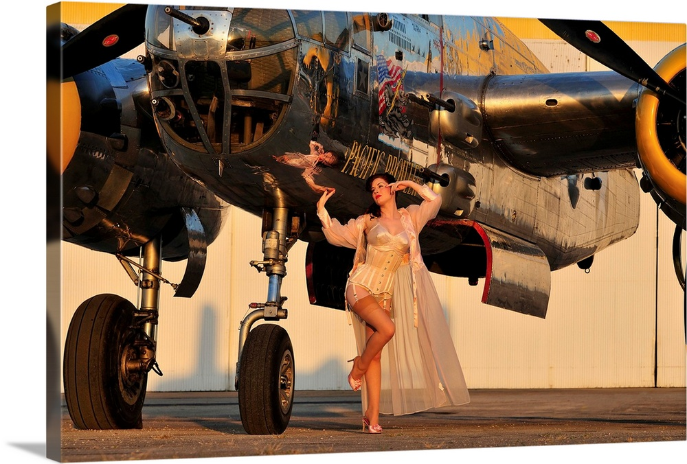 Large Solid-Faced Canvas Print Wall Art Print 30 x 20 entitled 1940's pin-up girl in lingerie posing with a B-25 bomber Solid-Faced Canvas Print entitled 1940s pin-up girl in lingerie posing with a B-25 bomber.  Sexy 1940s pin-up girl in lingerie posing with a B-25 bomber.  Multiple sizes available.  Primary colors within this image include Orange, Peach, Dark Gray, Gray Blue.  Made in USA.  All products come with a 365 day workmanship guarantee.  Archival-quality UV-resistant inks.  Archival inks prevent fading and preserve as much fine detail as possible with no over-saturation or color shifting.  Featuring a proprietary design, our canvases produce the tightest corners without any bubbles, ripples, or bumps and will not warp or sag over time.