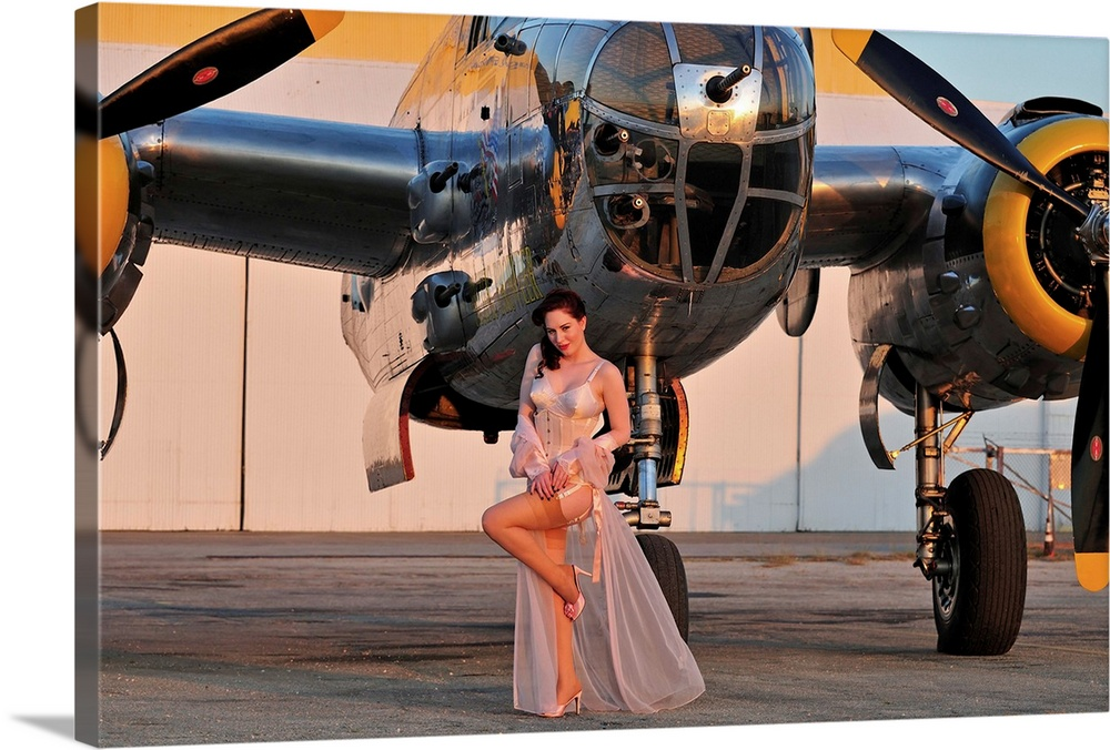Large Solid-Faced Canvas Print Wall Art Print 30 x 20 entitled 1940's pin-up girl in lingerie posing with a B-25 bomber Solid-Faced Canvas Print entitled 1940s pin-up girl in lingerie posing with a B-25 bomber.  Sexy 1940s pin-up girl in lingerie posing with a B-25 bomber.  Multiple sizes available.  Primary colors within this image include Orange, Black, Silver, Dark Forest Green.  Made in the USA.  Satisfaction guaranteed.  Inks used are latex-based and designed to last.  Featuring a proprietary design, our canvases produce the tightest corners without any bubbles, ripples, or bumps and will not warp or sag over time.  Canvas is handcrafted and made-to-order in the United States using high quality artist-grade canvas.