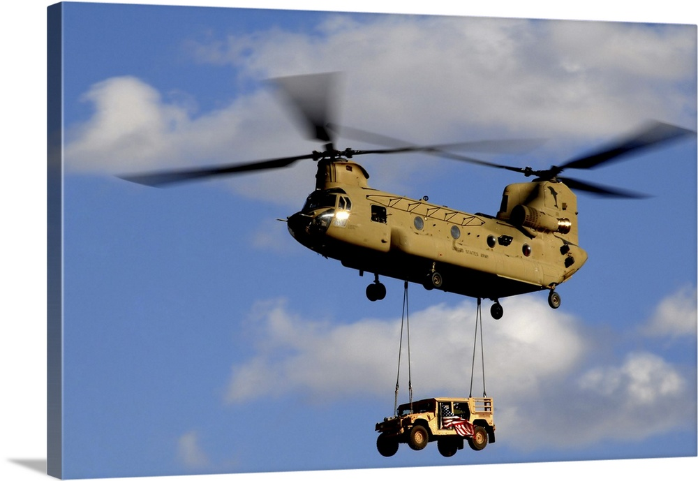Large Solid-Faced Canvas Print Wall Art Print 36 x 24 entitled A US Army CH-47 Chinook Helicopter Transports A Humvee Solid-Faced Canvas Print entitled A US Army CH-47 Chinook Helicopter Transports A Humvee.  March 4, 2010 - A U.S. Army CH-47 Chinook helicopter transporting a Humvee prepares to land at a forward operating base in southern Afghanistan. The Chinooks are the Armys primary cargo rotary aircraft and have been crucial throughout Operation Enduring Freedom.  Multiple sizes available.  Primary colors within this image include Brown, Black, Silver, Gray Blue.  Made in the USA.  All products come with a 365 day workmanship guarantee.  Archival-quality UV-resistant inks.  Canvas depth is 1.25 and includes a finished backing with pre-installed hanging hardware.  Featuring a proprietary design, our canvases produce the tightest corners without any bubbles, ripples, or bumps and will not warp or sag over time.