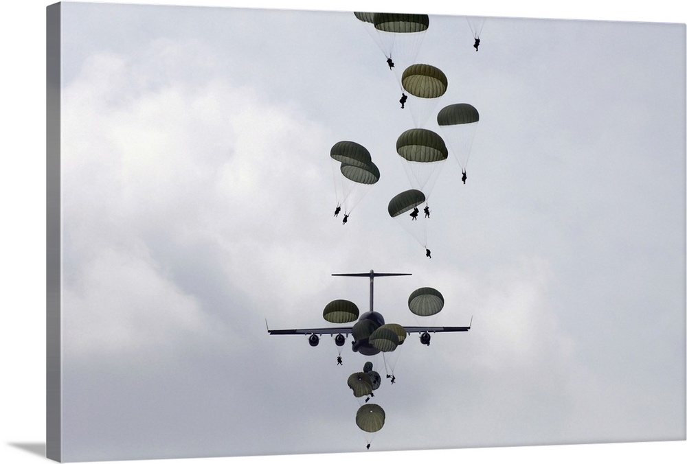 Large Gallery-Wrapped Canvas Wall Art Print 24 x 16 entitled Army Soldiers jump out of a C17 Globemaster III Gallery-Wrapped Canvas entitled Army Soldiers jump out of a C17 Globemaster III.  Wall art of soldiers parachuting from planes.  Multiple sizes available.  Primary colors within this image include Silver Dark Forest Green.  Made in USA.  All products come with a 365 day workmanship guarantee.  Inks used are latex-based and designed to last.  Canvas is acid-free and 20 millimeters thick.  Canvases are stretched across a 1.5 inch thick wooden frame with easy-to-mount hanging hardware.