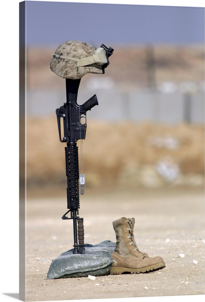 Large Solid-Faced Canvas Print Wall Art Print 20 x 30 entitled Boots, rifle, dog tags, and protective helmet stand in soli... Solid-Faced Canvas Print entitled Boots, rifle, dog tags, and protective helmet stand in solitude to honor fallen soldiers.  Boots, rifle, dog tags, and protective helmet stand in solitude to honor fallen soldiers.  Multiple sizes available.  Primary colors within this image include Dark Gray, Light Gray, White, Gray Blue.  Made in USA.  Satisfaction guaranteed.  Archival-quality UV-resistant inks.  Canvas is handcrafted and made-to-order in the United States using high quality artist-grade canvas.  Featuring a proprietary design, our canvases produce the tightest corners without any bubbles, ripples, or bumps and will not warp or sag over time.