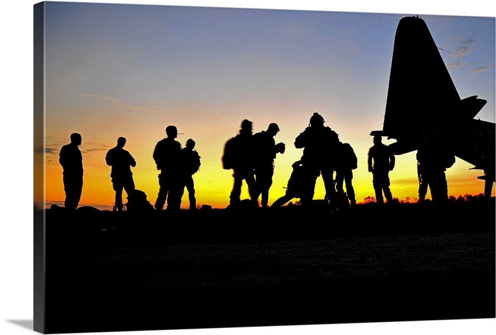 Large Solid-Faced Canvas Print Wall Art Print 36 x 24 entitled Green Berets prepare to board a KC-130 aircraft Solid-Faced Canvas Print entitled Green Berets prepare to board a KC-130 aircraft.  March 3, 2011 - U.S. Army Operational Detachment Alpha Soldiers, also known as Green Berets, secure their jump gear and prepare to board a KC-130 aircraft at the Stennis Space Center, Mississippi, during Emerald Warrior. Emerald Warrior is a U.S. Special Operations Command-sponsored, multiservice exercise designed to leverage lessons learned from Operations Iraqi Freedom and Enduring Freedom to provide trained and ready forces to combatant commanders.  Multiple sizes available.  Primary colors within this image include Orange, Yellow, Light Yellow, Black.  Made in the USA.  All products come with a 365 day workmanship guarantee.  Inks used are latex-based and designed to last.  Featuring a proprietary design, our canvases produce the tightest corners without any bubbles, ripples, or bumps and will not warp or sag over time.  Archival inks prevent fading and preserve as much fine detail as possible with no over-saturation or color shifting.