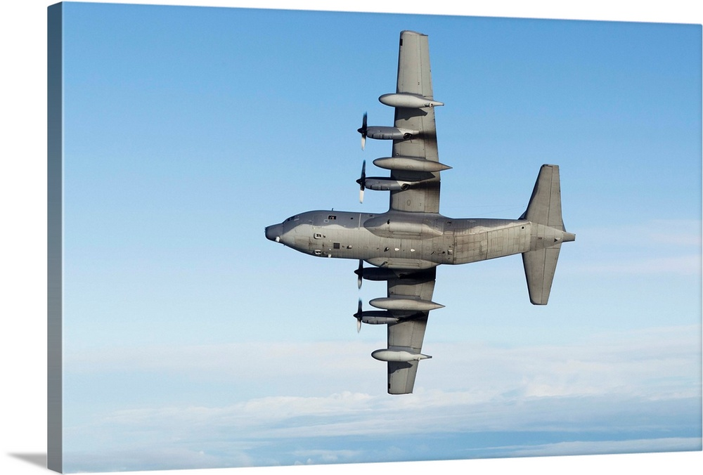 Large Solid-Faced Canvas Print Wall Art Print 30 x 20 entitled MC-130P Combat Shadow Solid-Faced Canvas Print entitled MC-130P Combat Shadow.  MC-130P Combat Shadow of the 67th Special Operations Squadron352nd Special Operations Group stationed at RAF Mildenhall, United Kingdom, December 2011.  Multiple sizes available.  Primary colors within this image include Black, Gray, Silver.  Made in the USA.  Satisfaction guaranteed.  Inks used are latex-based and designed to last.  Canvas depth is 1.25 and includes a finished backing with pre-installed hanging hardware.  Archival inks prevent fading and preserve as much fine detail as possible with no over-saturation or color shifting.
