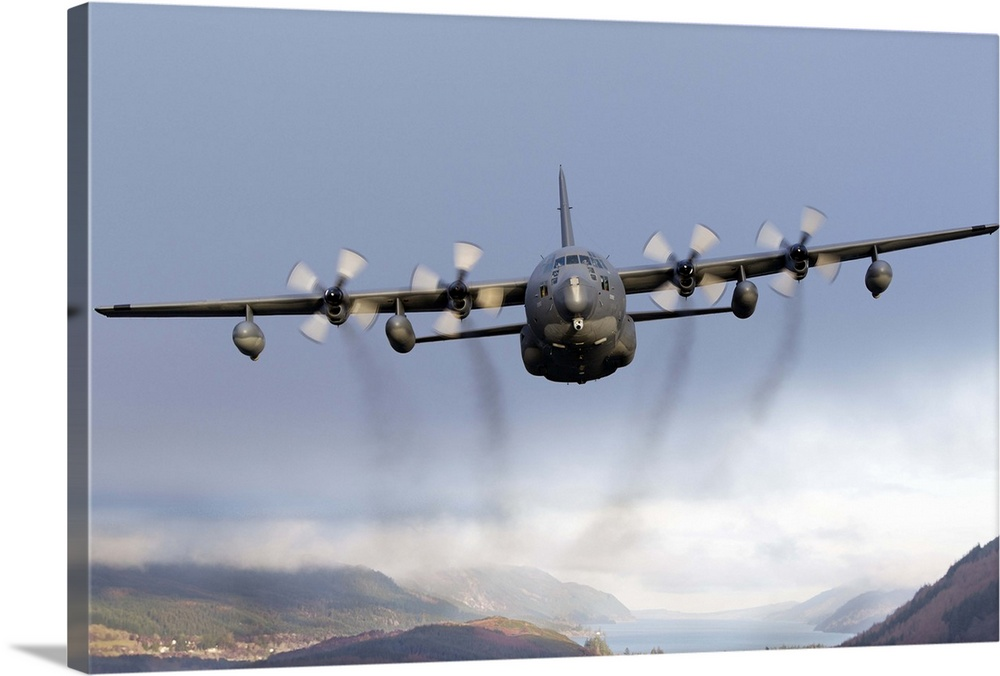 Large Solid-Faced Canvas Print Wall Art Print 30 x 20 entitled MC-130P Combat Shadow over Scotland Solid-Faced Canvas Print entitled MC-130P Combat Shadow over Scotland.  MC-130P Combat Shadow of the 67th Special Operations Squadron352nd Special Operations Group stationed at RAF Mildenhall, United Kingdom, December 2011.  Multiple sizes available.  Primary colors within this image include Black, Light Gray Blue.  Made in the USA.  All products come with a 365 day workmanship guarantee.  Archival-quality UV-resistant inks.  Archival inks prevent fading and preserve as much fine detail as possible with no over-saturation or color shifting.  Featuring a proprietary design, our canvases produce the tightest corners without any bubbles, ripples, or bumps and will not warp or sag over time.