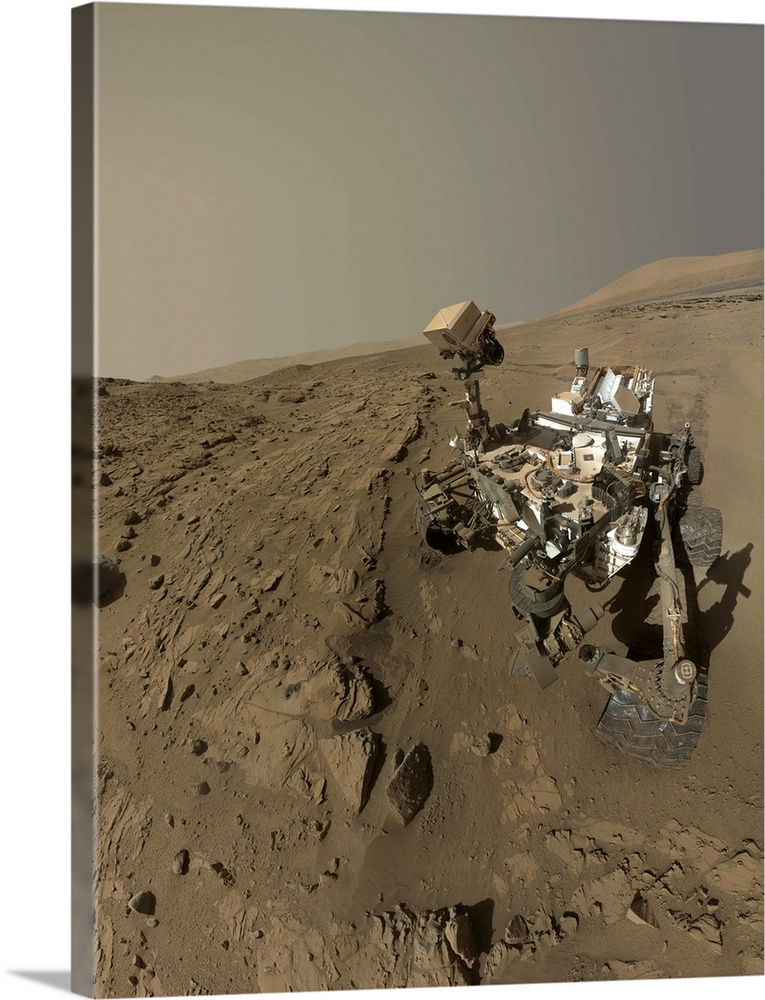 Large Solid-Faced Canvas Print Wall Art Print 30 x 40 entitled NASA's Curiosity Mars rover on planet Mars Solid-Faced Canvas Print entitled NASAs Curiosity Mars rover on planet Mars.  April 27, 2014 - NASAs Curiosity Mars rover used the camera at the end of its arm in April and May 2014 to take dozens of component images combined into this self-portrait where the rover drilled into a sandstone target called Windjana. The camera is the Mars Hand Lens Imager MAHLI. ..Winjana is within a science waypoint site called The Kimberley, where sandstone layers with different degrees of resistance to wind erosion are exposed close together...The view does not include the rovers arm.  It does include the hole in Windjana produced by the hammering drill on Curiositys arm collecting a sample of rock powder from the interior of the rock.  The hole is surrounded by grayish cuttings on top of the rock ledge to the left of the rover. The Mast Camera Mastcam atop the rovers remote sensing mast is pointed at the drill hole.  Multiple sizes available.  Primary colors within this image include Black, Gray, White.  Made in USA.  All products come with a 365 day workmanship guarantee.  Archival-quality UV-resistant inks.  Archival inks prevent fading and preserve as much fine detail as possible with no over-saturation or color shifting.  Canvas depth is 1.25 and includes a finished backing with pre-installed hanging hardware.