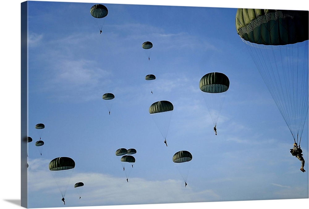 Large Gallery-Wrapped Canvas Wall Art Print 21 x 12 entitled Soldiers descend under a parachute canopy during Operation To... Gallery-Wrapped Canvas entitled Soldiers descend under a parachute canopy during Operation Toy Drop.  Soldiers descend under a parachute canopy during Operation Toy Drop.  Multiple sizes available.  Primary colors within this image include Black Gray Gray Blue.  Made in the USA.  Satisfaction guaranteed.  Archival-quality UV-resistant inks.  Canvas is a 65 polyester 35 cotton base with two acrylic latex primer basecoats and a semi-gloss inkjet receptive topcoat.  Canvas is acid-free and 20 millimeters thick.