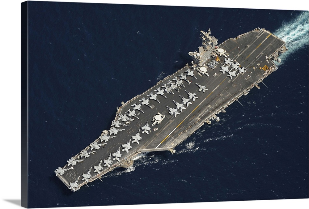 Large Solid-Faced Canvas Print Wall Art Print 36 x 24 entitled The aircraft carrier USS Dwight D. Eisenhower Solid-Faced Canvas Print entitled The aircraft carrier USS Dwight D. Eisenhower.  April 20, 2013 - The aircraft carrier USS Dwight D. Eisenhower CVN-69 is underway in the North Arabian Sea. Dwight D. Eisenhower is deployed to the U.S. 5th Fleet area of responsibility promoting maritime security operations, theater security cooperation efforts and support missions as part of Operation Enduring Freedom.  Multiple sizes available.  Primary colors within this image include Black, Gray, Silver.  Made in the USA.  All products come with a 365 day workmanship guarantee.  Inks used are latex-based and designed to last.  Canvas is handcrafted and made-to-order in the United States using high quality artist-grade canvas.  Archival inks prevent fading and preserve as much fine detail as possible with no over-saturation or color shifting.