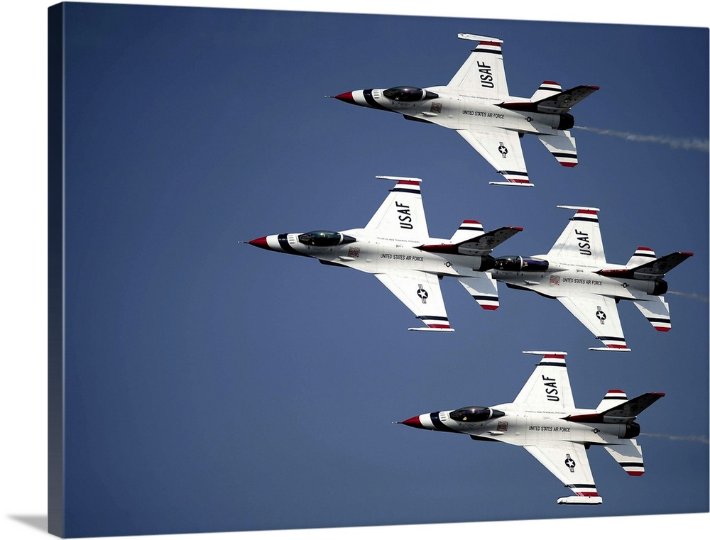Large Gallery-Wrapped Canvas Wall Art Print 24 x 17 entitled The U.S. Air Force Thunderbird demonstration team Gallery-Wrapped Canvas entitled The U.S. Air Force Thunderbird demonstration team.  April 9 2011 - The U.S. Air Force Thunderbird demonstration team performs in their F-16 CD Fighting Falcons at the Charleston Air Expo Joint Base Charleston South Carolina.  The Thunderbirds closed the 2011 Charleston Air Expo in dramatic fashion as they dazzled an expected crowd of 100000 pe...  Multiple sizes available.  Primary colors within this image include Black White Muted Blue.  Made in the USA.  All products come with a 365 day workmanship guarantee.  Inks used are latex-based and designed to last.  Canvases have a UVB protection built in to protect against fading and moisture and are designed to last for over 100 years.  Canvas is acid-free and 20 millimeters thick.