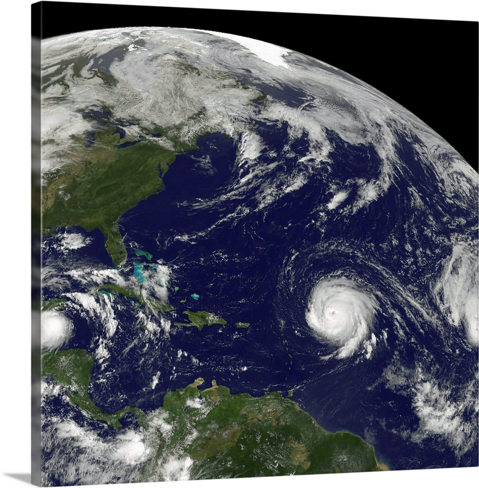 Large Solid-Faced Canvas Print Wall Art Print 20 x 20 entitled Three tropical cyclones active in the Atlantic Ocean basin Solid-Faced Canvas Print entitled Three tropical cyclones active in the Atlantic Ocean basin.  September 15, 2010 - Three tropical cyclones active in the Atlantic Ocean basin, two of them powerful Category Four hurricanes. Tropical Storm Karl left was making landfall in Mexicos Yucatan Peninsula, Category 4 Hurricane Igor was spinning in the Atlantic Ocean center over 1000 miles southeast of Bermuda, and Category 4 Hurricane Julia trailing to Igors east far right about 600 miles west-northwest of the Cape Verde Islands in the eastern Atlantic Ocean.  Multiple sizes available.  Primary colors within this image include Black, Light Gray, Dark Forest Green.  Made in USA.  All products come with a 365 day workmanship guarantee.  Inks used are latex-based and designed to last.  Canvas is handcrafted and made-to-order in the United States using high quality artist-grade canvas.  Featuring a proprietary design, our canvases produce the tightest corners without any bubbles, ripples, or bumps and will not warp or sag over time.