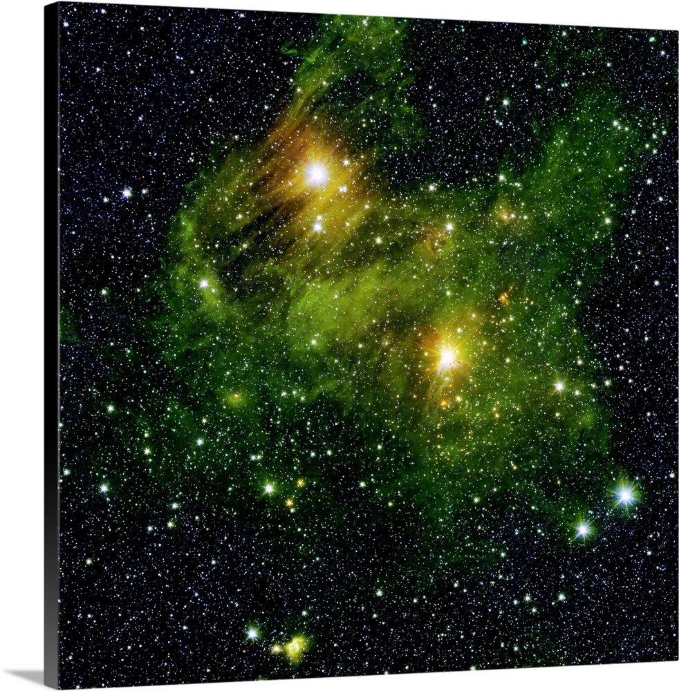Large Solid-Faced Canvas Print Wall Art Print 20 x 20 entitled Two extremely bright stars illuminate a greenish mist in de... Solid-Faced Canvas Print entitled Two extremely bright stars illuminate a greenish mist in deep space.  Two extremely bright stars illuminate a greenish mist in deep space. This fog is comprised of hydrogen and carbon compounds called polycyclic aromatic hydrocarbons PAHs, which are found right here on Earth in sooty vehicle exhaust and on charred grills. In space, PAHs form in the dark clouds that give rise to stars. These molecules provide astronomers a way to visualize the peripheries of gas clouds and study their structures in great detail. PAHs are not actually green a representative color coding in these images lets scientists observe PAHs glow in the infrared light that Spitzer sees, and which is invisible to us.  Strange streaks, likely dust grains that lined up with magnetic fields, distort the star in the top left. The fairly close, well-studied star GL 490 gleams in the middle right. The new observations have revealed several small blobby outflows of gas from nearby forming stars, which indicate their youth. Such outflows are a great way to target really young, massive stars in their very earliest, hard-to-catch stages.  Multiple sizes available.  Primary colors within this image include Dark Yellow, Peach, Black, Gray Blue.  Made in USA.  All products come with a 365 day workmanship guarantee.  Inks used are latex-based and designed to last.  Canvas is handcrafted and made-to-order in the United States using high quality artist-grade canvas.  Canvas depth is 1.25 and includes a finished backing with pre-installed hanging hardware.