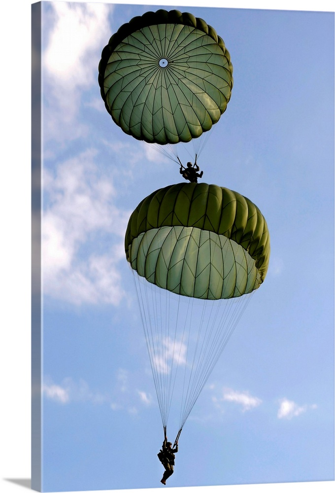 Large Gallery-Wrapped Canvas Wall Art Print 16 x 24 entitled U.S. Army Soldiers parachute down after jumping from a C 130 ... Gallery-Wrapped Canvas entitled U.S. Army Soldiers parachute down after jumping from a C 130 Hercules.  September 12 2010 - U.S. Army Soldiers from the 82nd Airborne Division parachute down after jumping from a C-130 Hercules during Airborne Operations.  Multiple sizes available.  Primary colors within this image include Sky Blue Black White Dark Forest Green.  Made in the USA.  Satisfaction guaranteed.  Archival-quality UV-resistant inks.  Canvases have a UVB protection built in to protect against fading and moisture and are designed to last for over 100 years.  Museum-quality artist-grade canvas mounted on sturdy wooden stretcher bars 1.5 thick.  Comes ready to hang.