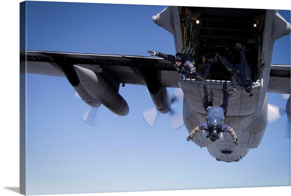 Large Gallery-Wrapped Canvas Wall Art Print 24 x 16 entitled U.S. Navy Parachute Team, the Leap Frogs, jump from a C-130 H... Gallery-Wrapped Canvas entitled U.S. Navy Parachute Team the Leap Frogs jump from a C-130 Hercules.  U.S. Navy Parachute Team the Leap Frogs jump from a C-130 Hercules.  Multiple sizes available.  Primary colors within this image include Black Muted Blue Pale Blue.  Made in USA.  All products come with a 365 day workmanship guarantee.  Inks used are latex-based and designed to last.  Canvas is designed to prevent fading.  Canvas frames are built with farmed or reclaimed domestic pine or poplar wood.