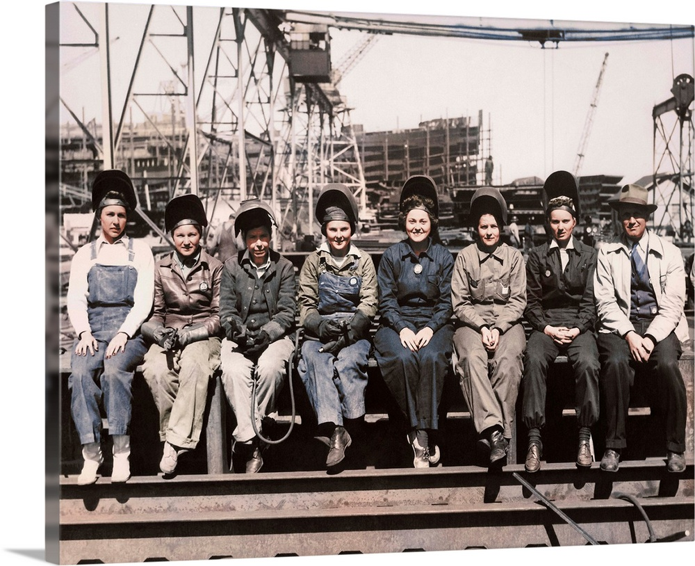 Large Gallery-Wrapped Canvas Wall Art Print 20 x 16 entitled Women welders wearing protective clothing and seated outdoors Gallery-Wrapped Canvas entitled Women welders wearing protective clothing and seated outdoors.  Women welders wearing protective clothing and seated outdoors.  Multiple sizes available.  Primary colors within this image include Dark Gray, White.  Made in USA.  Satisfaction guaranteed.  Inks used are latex-based and designed to last.  Canvas is designed to prevent fading.  Canvases are stretched across a 1.5 inch thick wooden frame with easy-to-mount hanging hardware.
