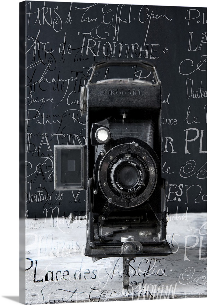 Large Gallery-Wrapped Canvas Wall Art Print 16 x 24 entitled Vintage Camera I Gallery-Wrapped Canvas entitled Vintage Camera I.  Multiple sizes available.  Primary colors within this image include Black Gray Silver.  Made in USA.  Satisfaction guaranteed.  Archival-quality UV-resistant inks.  Museum-quality artist-grade canvas mounted on sturdy wooden stretcher bars 1.5 thick.  Comes ready to hang.  Canvas frames are built with farmed or reclaimed domestic pine or poplar wood.